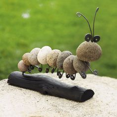 ROCK CATERPILLAR- I am a sucker for this kind on natural crafts made from nature. Cute as a bug in the rug.