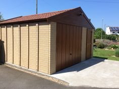 Apex 20 concrete garage in sectional buff brick finish Concrete Garages, Prefab, Brick, Garage Doors, Outdoor Decor, Home Decor, Decoration Home, Room Decor, Bricks