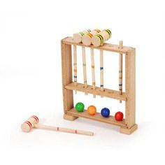 A classic game set to include in your dollhouse, this mini croquet set keeps all of the traditional game pieces neatly stored in a rectangular croquet stand. In addition to dollhouse decorating thi… Miniature Crafts, Miniature Fairy Gardens, Mini Gardens, Fairy Games, Fairy Garden Supplies, Gardening Supplies, Traditional Games, Fairy Garden Accessories, Dollhouse Accessories