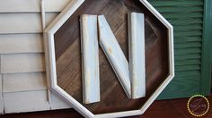 barnwood craft with initial made from baseboard scraps