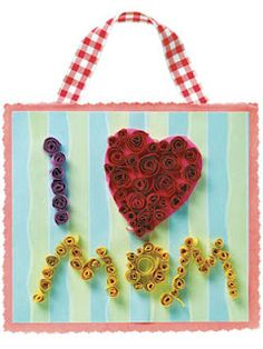 """""""I Love Mom"""" mother's day craft from curled strips of construction paper."""