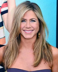"Jennifer Aniston has said that her hair is naturally wavy so her famous much copied layered shaggy ""Rachel"" style was shaped with flat irons and a lot of blow drying. Now she's known for sporting casually tousled layers which beautifully frame her face."