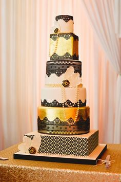 Six Tier Black White & Gold Art Deco Inspired Wedding Cake | Great Gatsby 1920s Vintage Inspired Wedding | Black & Gold Colour Scheme | http://www.rockmywedding.co.uk/jayne-andrew/ | Images by Matthew Long Photography