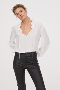 Check this out! Wide-cut blouse in airy, woven fabric with small ruffle trim at neckline. Long, wide sleeves with drawstring at cuffs. Open at top with a narrow tie. - Visit hm.com to see more.