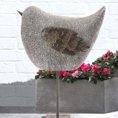 Features:  -Whimsical collection.  -Style: Traditional.  -Weather resistant.  -Free standing.  Product Type: -Statue.  Color: -Antique.  Distressed: -Yes.  Style (Old): -Traditional.  Material: -Metal