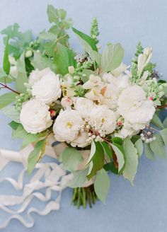 lush bridal bouquet with white blooms & textural greens.