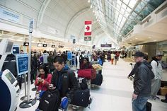 Passengers line-up during flight delays at Pearson International Airport in Toronto on Tuesday January (Photo by THE CANADIAN PRESS/Aaron Vincent Elkaim) Toronto Zoo, Toronto Star, Canadian Airlines, Air Transat, Pilot Uniform, Air Charter, Facial Recognition, Air Travel, International Airport