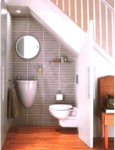 Pictures of BATHROOMS BELOW THE STAIRWAY This is a good idea to use the space under the stairs . If you are designing your home but could be a nightmare if the previous owner simply added it. Check with a good contractor for options. This isn't always feasible with plumbing and safe home design.