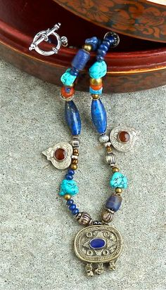 THREE AFGHANI PENDANTS - Statement Necklace - Turquoise - Lapis Lazuli - Tribal -  Metal Beads - Single Strand -. $225.00, by The Joy Moos Collection via Etsy.