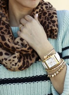 animal print scarf with stripes and gold jewelry