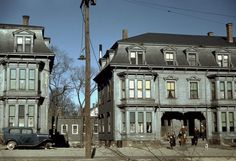 Children in the tenement district, Brockton, Massachusetts. December 1940. Photograph by Jack Delano. These duplexes must have been fairly grand when they were new, probably around the turn of the century. They look like the house where Granny and Tweety Bird lived. Are they still there?