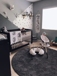 We're just head over heels for this monochromatic nursery. Dark colors in nurseries are trending for 2017!