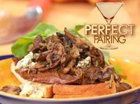 Sliced steak sandwiches with blue cheese and sherry mushrooms