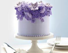 Beautiful single tier cake with purple flower details.