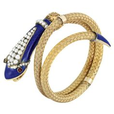 Victorian snake bangle, circa 1860. Gold, enamel, split pearls, and garnets. Via Diamonds in the Library: http://diamondsinthelibrary.com/snakes-on-a-bangle/