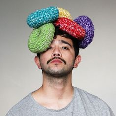When Australian artist Phil Ferguson moved to Melbourne, he found himself alone in a new city. So he decided used his crochet skills to make friends by creating headwear in the shape of food.