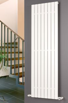 The Eucotherm range of Mars vertical designer radiators is a modern and stylish way to update your home. Designed to integrate seamlessly into your existing central heating system, these vertical radiators feature a flattened tube design to offer a wide h Home Radiators, Flat Panel Radiators, Vertical Radiators, Designer Radiator, Central Heating, White Paneling, Towel Rail, Stairs, Modern