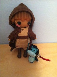 Custom mini Lalaloopsy Jedi.  Clothing is hand sewn and the light sabers are made from color beads and a necklace clasp.