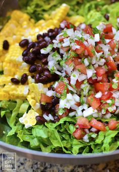 Southwestern Chopped Salad is a party on a platter! Filling, fresh, and colorful, this gluten-free entree salad recipe will liven up your dinner table.   iowagirleats.com