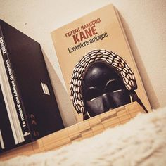 . . I'm reading the ambiguous adventure  by Cheik Hamidou Kane a senegalese author. It's about Samba Diallo and his journey from traditional islamic practice  in Senegal to advanced studies of philosophy in Paris. The dilemma of traditionnal values against the french assimilationist policies in the wake of colonial conquest . . . .  #africanwriters #book #bookstagram #diversereads #readdiversebooks #cheikhhamidoukane #laventureambigue #currentread #bookidea #gltlove…