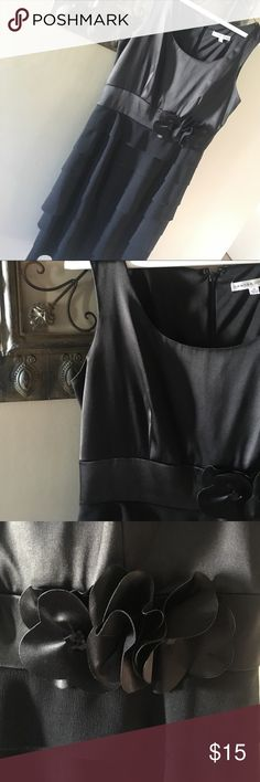 """Black dress Super cute black dress! Perfect for special occasions! Satin kind material up top and a soft ruffle fabric on the skirt part! Flowers on the """"belt area"""" with black rhinestones! Only worn once, in excellent condition!! Zipper and flowers intact! No pills or tears!! Bought from Nordstrom! Sandra Darren Dresses Midi"""