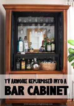 Shine Your Light: TV Armoire Turned Bar Cabinet; great idea!!!