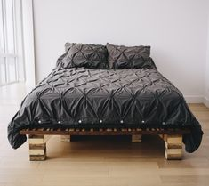 This custom-built platform bed is made from reclaimed maple, oak, sapele, and walnut strips.