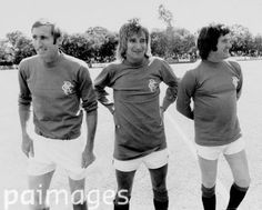 Rare shot of Rod Stewart in a Glasgow Rangers shirt, alongside Jackie McInally (l) and Rangers legend Jim Baxter (r) for Scotland - Charity Match - Scotland v England - 25th July 1976