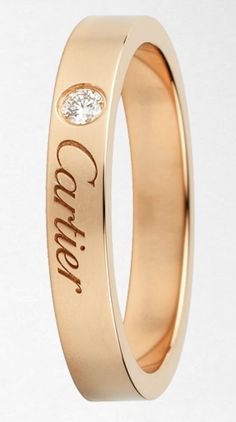 simple but an ever-lasting classic by Cartier in 18k gold with a diamond.