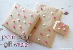Creative: Eleven Simple Ways To Gift Wrap  (Adorable Pom pom wrapping paper via A Bubbly Life)