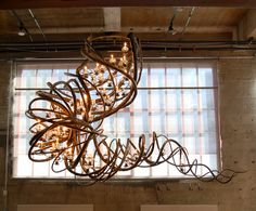 Featured in California Home and Design, this Community Chandelier is a sculpture that occupies the space in a chaotic swirling levitation of luminescence, balancing the heavy and the light -- propelling one another