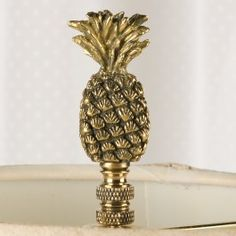 $19.95 Brass Pineapple Finial at Sturbridge Yankee - Oh gosh, I just have to have one of these for each of my living room lamps...it's a perfect match for my antique bookends