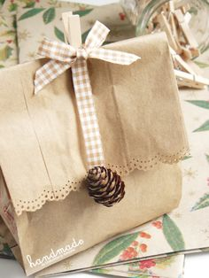 Brown paper bag with gingham ribbon, pinecone and pin. Present Wrapping, Creative Gift Wrapping, Creative Gifts, Wrapping Ideas, Pretty Packaging, Gift Packaging, Paper Bag Wrapping, Paper Bags, Gift Wraping