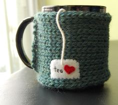 Sipping your hot tea was never so cute as with a hand knit and embroidered cozy wrapped around your mug! Perfect for decorating and insulating your cup