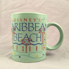 Vintage Disney Teal Caribbean Beach Resort 10 oz Coffee Mug 1988 Band Palm Trees - SOLD for $15