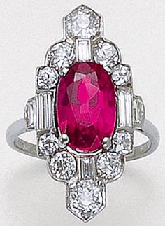 An Art Deco ruby and diamond ring, 1920s. Set with an oval ruby, bordered by circular-cut and baguette diamonds, mounted in platinum. #ArtDeco #ring