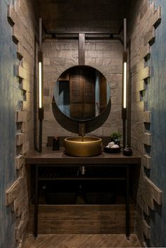 Bathroom Remodel with stone cladding and gold cladded basin