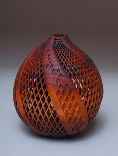 Wood by J Paul Fennell. I initially had this pinned as gourd art but researched this piece to find that J Paul Fennell is a woodturning artist. It had me fooled. My apologies.