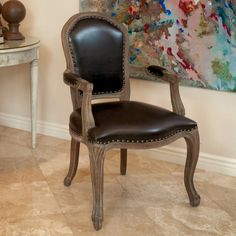 With a Victorian-inspired design, this wood arm chair will be sure capture your guests' attention. Available in marbled brown for a sophisticated touch, this elegant chair comes with padding in the seat, back, and arms for a comfortable seating option.