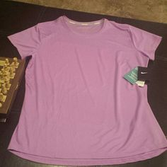 NWT Nike Dri-fit shirt XL Purple orchid color..like deep lavender.  NEW with tags. fits like a 14/16. From smoke free home Nike Tops Tees - Short Sleeve
