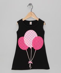 "Black & Fuchsia Balloon A-Line Dress - Infant, Toddler & Girls [   ""Pretty tulips will feel right at home in the sweet floral wonderland of this denim babydoll dress. Featuring adjustable straps, decorative buttons and ruffle embellishments, this piece is the perfect cozy garden for cuties to bloom in."",   ""Boasting a peppy polka dot balloon appliqué, this dress is full of fun. Plus, its soft knit fabric creates a comfy feel that any little sugar pie is destined to cottonHand wash; hang…"