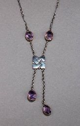 CELTIC KNOT & AMETHYSTS BY MURRLE BENNETT  1905-1910.  Square section Celtic Knot panel supporting two cut amethyst roundels, on a chain with two similar amethyst roundels stamped MB & Co, 950.