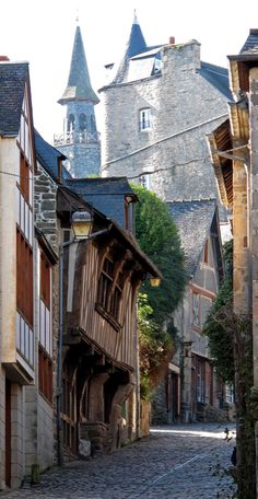 "Medieval Dinan, France • photo: Olivier Schram on Flickr.  In Europe.... It happened so often as we would ask for directions to, say, a grocery store.  ....inevitably, someone would say.  ""yes, just past the castle...""    Do they ever get used to walking past a castle????"