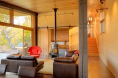 Living room. Miner's Refuge, by Johnston Architects. Mazama, Washington.