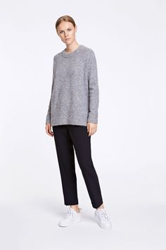 089f6e8f8147a This longer length sweater has a loose and cosy fit. Knitted in an alpaca  and merino wool yarn for a soft feel and fluffy look. The round neckline  and long ...