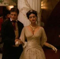 Firefly is a great example of playing with the future past, and Shawna Trpcic's costumes make it feel solid and real.  For Shindig, she actually loaned Inara her own gold wedding dress.  Mal looks like a victorian, or perhaps a cowboy in his formal best.