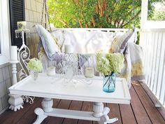 There are no fancy showpieces in the shabby chic home. Everything is recycled, upcycled and lived-in. This relaxed rule carries into outdoor rooms too. RMS user cobbcottage's porch is used all year long, so it was paramount that the space be comfy and inviting. A thick, antique quilt and printed pillows ensure that the porch swing is used for more than just curb appeal. - From HGTV website