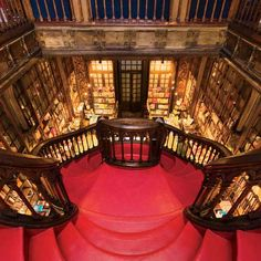 Lello Bookshop, Porto, Portugal - The elaborate neo-Gothic façade of this former library barely hints at the opulence inside: carved wood, gilded pillars, ornamented ceilings, and a gorgeous red staircase lit by a stained-glass atrium. (550×550)