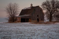 An old weathered barn is the last remaining building on this farm. Although it has no doors or windows to protect the interior from the elements, equipment is still being stored so this barn may have a chance to remain standing for a few more years. Lasalle County, IL