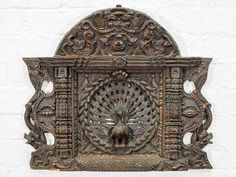 An extremely finely carved peacock surrounded by dragons and an image of Yama, the lord of death, in dark wood and made to hang on the wall. Wood Carving Tools, Indian Home Decor, Silk Road, Dark Wood, Wood Art, Peacock, Clock, Gallery, Wall